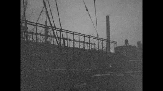 1940s: Pan across factories, boats by dock.