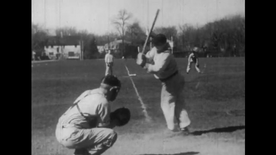 1940s: Teenager and little boy strike out and throw bat.  Boy throws himself down and has a fit.  Teenager lays on ground and pulls at hair and punches ground.