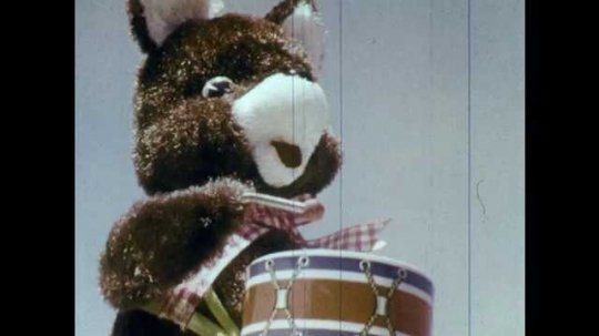 1970s: UNITED STATES: toy bear with drum. Girl