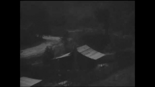1930s: House in the mountains. Title card. Two women walk out of gate at house, wearing hats. Women walk out of another gate to horse hitched outside.