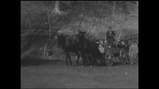 1930s: UNITED STATES: children arrive at building on horse drawn cart. Nurses on horseback