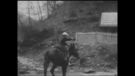 1930s: UNITED STATES: boy rides horse to clinic. Boy climbs down from horse. Boy calls for nurse