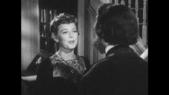 1940s: Woman talks to man, touches man