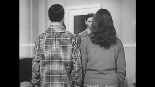 1950s: Two couples stand across from each other.  The female partners pass through the other couple.  Couples join hands.