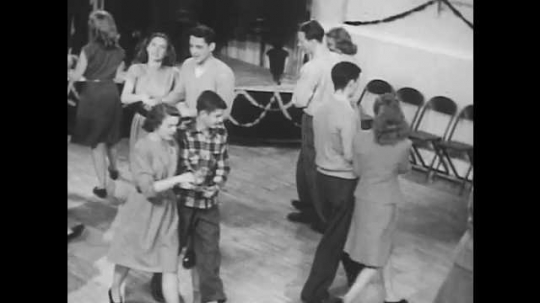 1950s: Young men and women dance.  Couples bow to each other.  Couples stand together to form square.   Two couples dance while two couples wait.