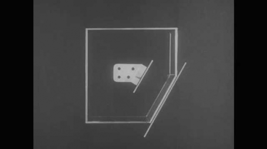 1950s: UNITED STATES: incline of view of object inside box. Auxilary elevation