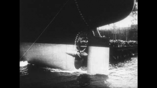 1950s: UNITED STATES: propeller on ship during launch.