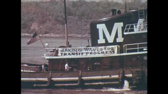 Banner on tugboat reads