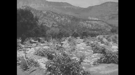 1940s: UNITED STATES: water erosion in fields. Fields without top soil after rain storm. View across valley and mountains