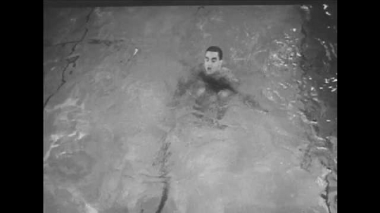 1940s: Man does somersaults underwater. Two boys wash hands and faces in bathroom, dry hands and face on towel. Infected eyelid.