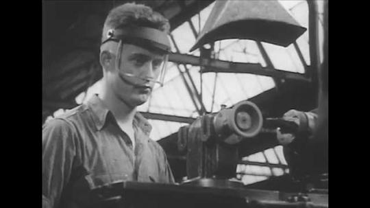 1940s: Man wears plastic visor, works drilling machine. Man folds down welding mask, welds metal.