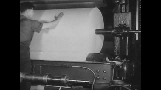 1950s: Man smooths roll of paper in machine. Man carries wall board from industrial machine. Map of Canada with text and statistics superimposed.