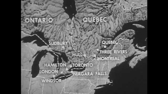 1950s: Map of Canada with text. Map of Canada with circles. Water falls from large hydroelectric plant. Man walks among large hydroelectric turbines.