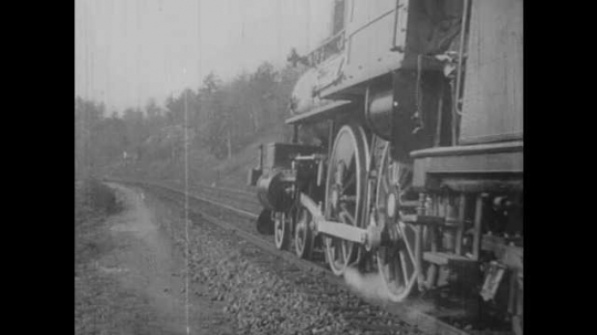 1900s: UNITED STATES: robbers jump from train. Robbers run through trees