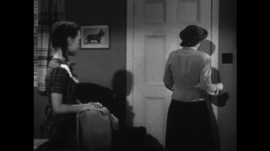 United States: 1950s: lady leaves house. Lady forgets bag. Lady goes through door. Girl waves at mother. Lady gets in car.