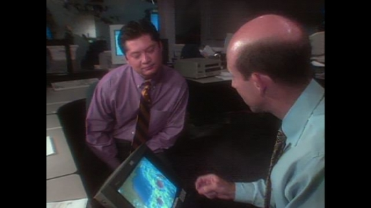UNITED STATES: 1990s: men look at weather forecast. Students in classroom. Computer simulation of hurricanes. Computer animation of satellite in space. Plane on runway.