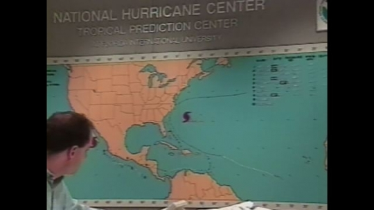 UNITED STATES: 1990s: map on wall of National Hurricane Centre. Computers in office. Computer models of hurricanes.