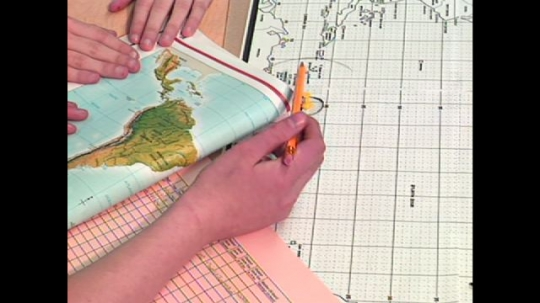 UNITED STATES: 1990s: students calculate areas at risk of hurricane. Teacher speaks to class. Students study meteorology.