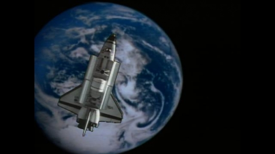 UNITED STATES: 1990s: animation of space shuttle over Earth.
