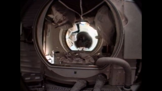 UNITED STATES: 1990s: astronaut moves through space shuttle compartments. Space shuttle lands on runway.