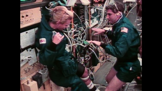 UNITED STATES: 1990s: astronauts work out in space. Physiology testing and research in space