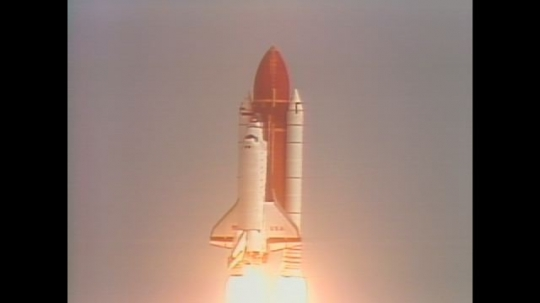 UNITED STATES: 1990s: shuttle launches into space. Astronauts move around space station.