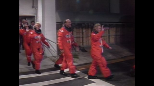 UNITED STATES: 1990s: astronauts walk out to space shuttle before mission. Animation of blood and heart.