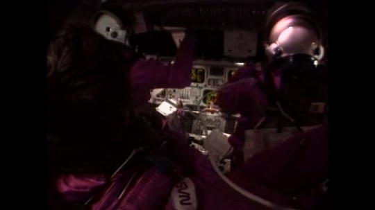 UNITED STATES: 1990s: astronauts in pink suits in space. Simulation of mission to Mars.