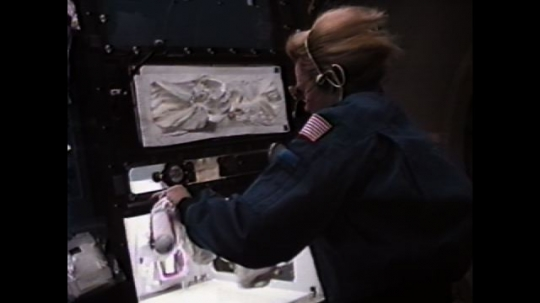 UNITED STATES: 1990s: astronaut conducts experiments on space motion sickness. Rotating dome.