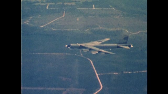 UNITED STATES: 1970s: Side view of plane in sky. Internal view of plane cockpit during flight.