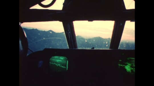 UNITED STATES: 1970s: cockpit of manned bomber plane. Triad forces. Launch of missiles.