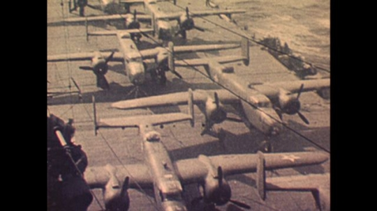 UNITED STATES: 1970s: planes lined up on runway. Plane drops bomb. Planes in sky