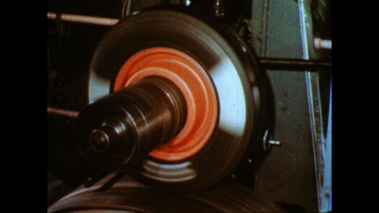 United States: 1980s: wheel spins in lab. Test wheel travels over wet surface. Drum speed dial records data.