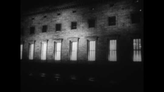 Europe 1940s: building exterior at night. Hitler land generals in planning room. Title for