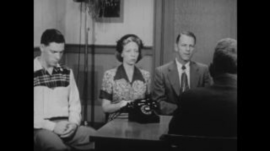 United States: 1950s: family sit in office interview. Man talks to teenagers.