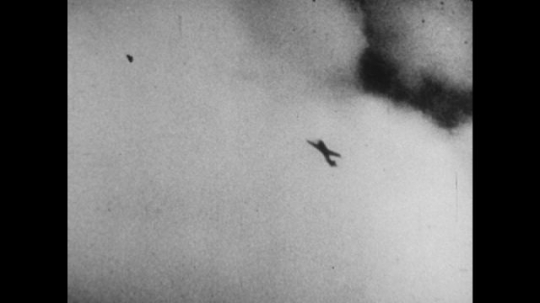 United States, 1940s: plane flies in cloudy sky. Plane takes hit in sky. Wing of plane damaged by bullets. Gunfire from plane. Close up of bullets. Plane falls from sky.