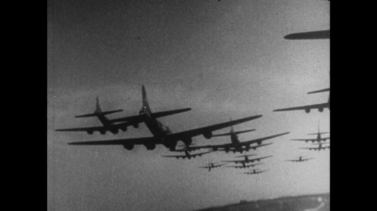 United States, 1940s: war planes in sky. Bombs drop from plane. Smoke in sky.