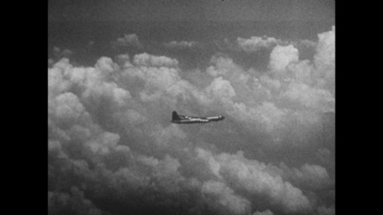 United States, 1940s: plane flies over clouds in sky. Planes in sky. Plane takes off in poor visibility. View of plane in flight from below.