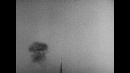 United States, 1940s: smoke in sky. Rocket launches through sky. Tail shows rocket path. Rocket crashes to ground