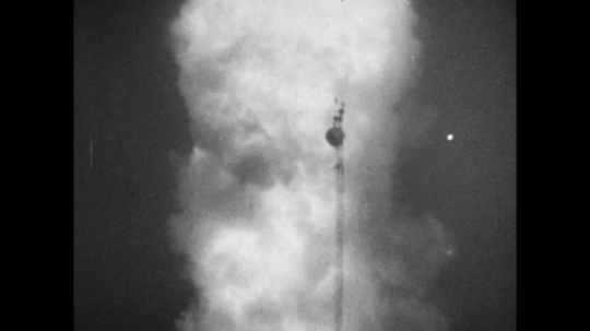 United States, 1940s: flames and smoke as rocket launches. Rocket launches into sky.