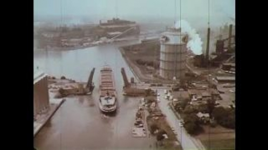 UNITED STATES: 1960s: ship on waterway by factory. Ford factory from above.