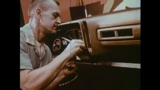 UNITED STATES: 1960s: man paints panel on car. Man designs fabric for car. Clay models of vehicles.