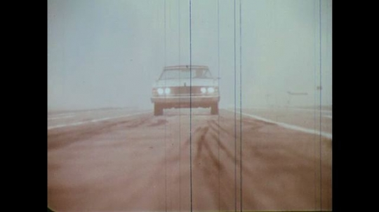 UNITED STATES: 1960s: car on test track. Emergency brake. Car on machine, in wind tunnel. Frozen car.