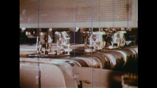 UNITED STATES: 1960s: glass production in factory. Vinyl making process. Upholstery process.