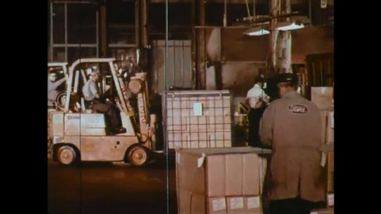 UNITED STATES: 1960s: car production parts inside a warehouse. Transportation of component parts to plants.