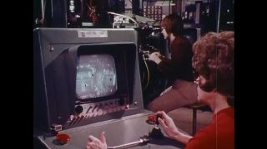 UNITED STATES 1970s: Women working with machines, zoom in on woman / Close up of microchip / Man adjusts equipment, pan to man looking at car engine / Car driving.