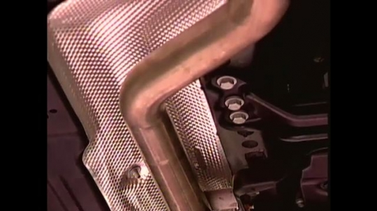 UNITED STATES: 1990s: catalytic converter inside metal case. Computer animation of catalytic converter chemical process.