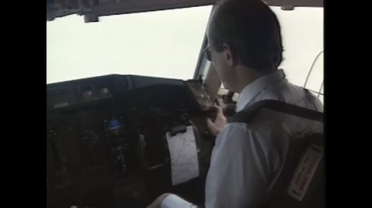 UNITED STATES: 1990s: pilot in cabin of plane. Close up of monitor in plane.