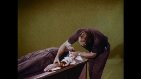 United States: 1970s: man inspects injury to casualty