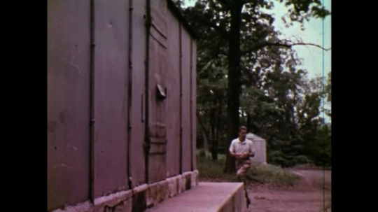 UNITED STATES: 1970S: man arrives at explosives storage magazine. Man loads explosives into truck.